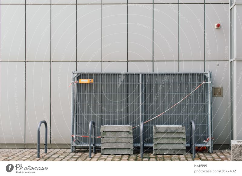 barricaded wire mesh on an external facade Protective Grating Hoarding Metalware cordon lattice fence Safety Fences Abstract flutterband gray wall Facade Line
