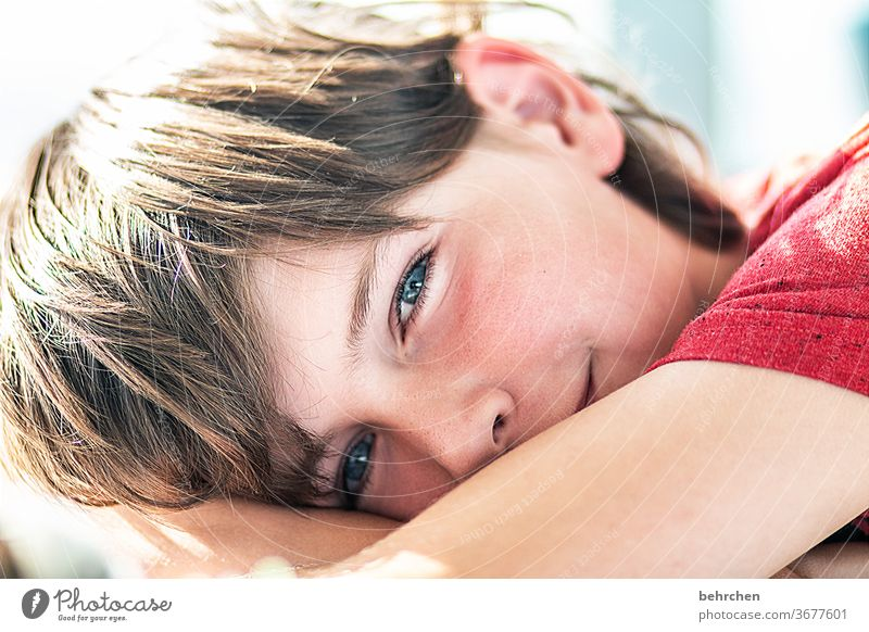 are you dreaming? Laughter Grinning Impish Love luck Son smile allure Charming pretty fortunate Contentment Head Eyes Sunlight Child Close-up portrait Contrast