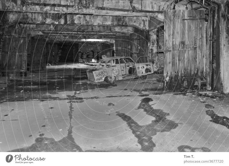 Garages in Friedrichshain trobant car Car Vehicle Deserted Means of transport Underground garage Black & white photo Berlin Ruin Broken Town Parking lot