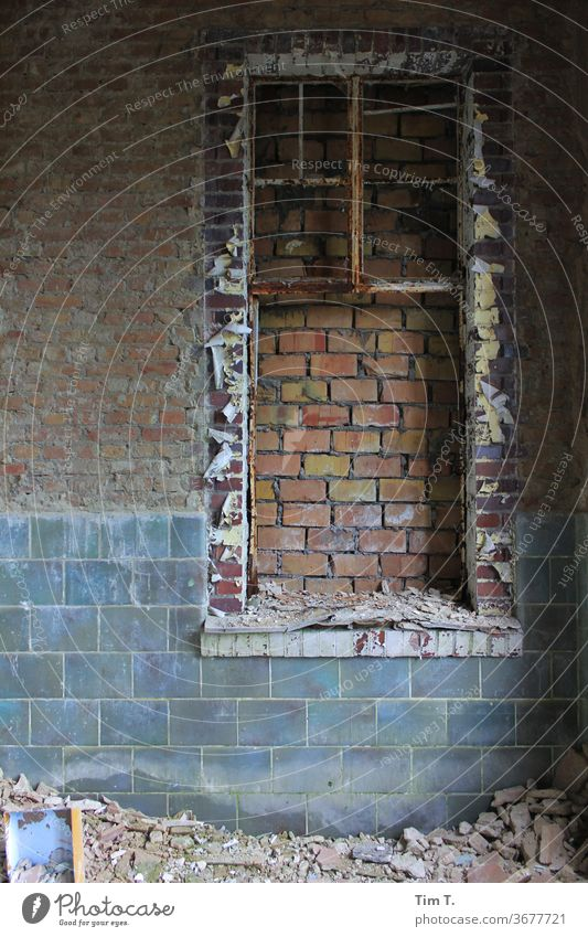 Window without view stonewalled bricked up Wall (barrier) Wall (building) Exterior shot Facade Deserted Colour photo House (Residential Structure) Day Old built