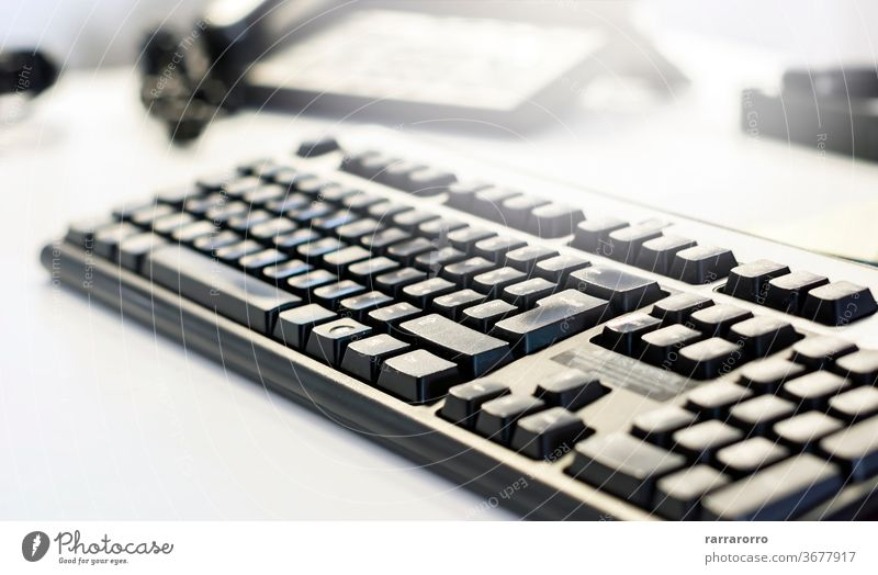 a black computer keyboard on an office table. technology background business button internet closeup communication work electronic pc white object modern