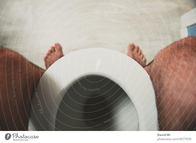 Man sitting on the toilet Toilet Sit Bathroom Urinate White foot Legs toilet lid Bowel movement