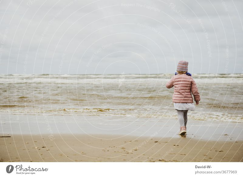 the child and the rough seas Child girl Lake North Sea Ocean Waves Going explore inquisitive vacation inquisitorial Water attractive spellbound Anonymous