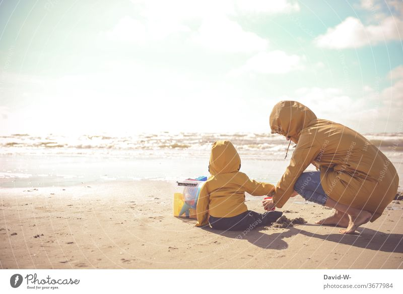 Mother and child with Frisian mink playing together on the beach friesennerz Child Son Mother with child Mother with son Playing Beach atmospheric Sunlight