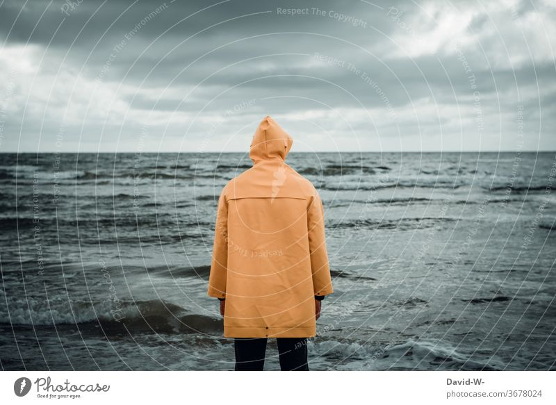 Man with Frisian mink on the beach watching the sea Beach friesennerz Observe monitored Ocean ocean Waves conceit somber by oneself forsake sb./sth. peril Water