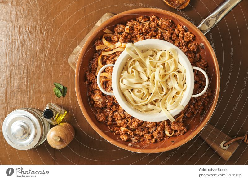 Pasta and Bolognese sauce on table bolognese pasta food prepare cook pan cuisine culinary ingredient meal recipe meat kitchen natural homemade tasty dinner