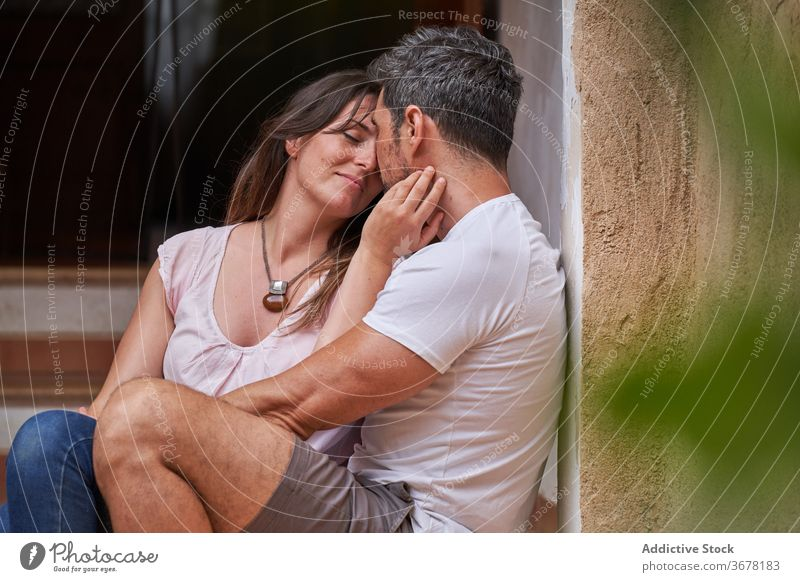 Tender couple hugging in city enjoy together stroll relax relationship smile tender middle age husband wife weekend eyes closed embrace bonding happy love