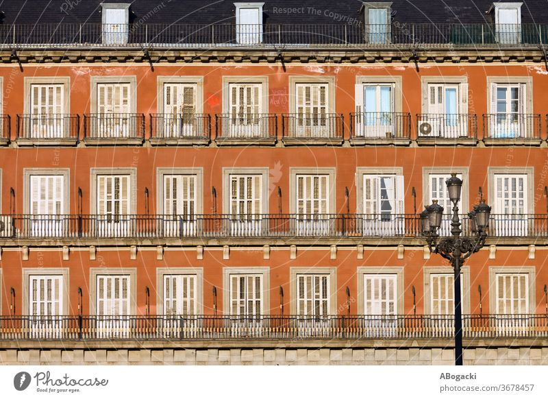 Historic Facade at Plaza Mayor in Madrid, Spain facade tenement house block building apartment windows madrid old europe exterior historic housing architecture