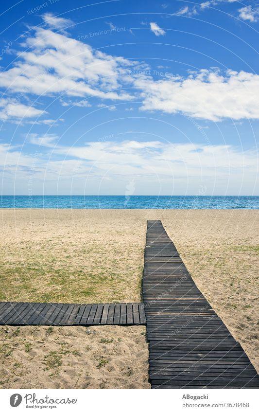 Beach with wooden boardwalk on Costa del Sol in Marbella, Spain beach sea ocean marbella spain vacation nature shore sandy mediterranean copyspace horizon water