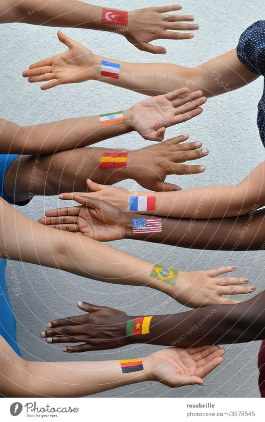 People from different countries | Neighbourhoods people International nations disparate in common Flags flags Arm hands togetherness at the same time diversity
