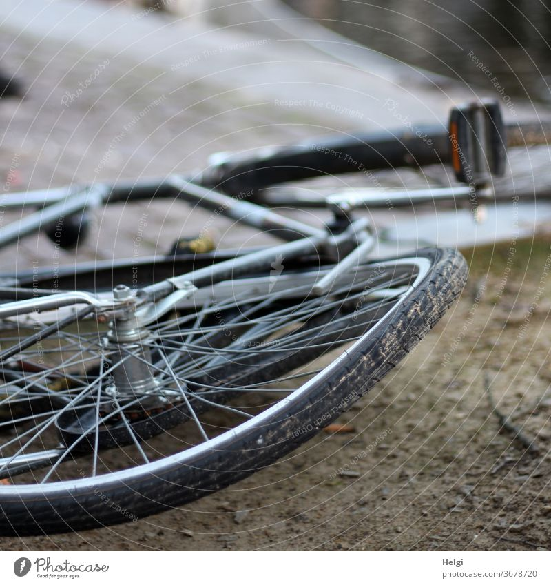 bent - old bicycle with bent wheel lies on the ground Bicycle Wheel Broken warped Exterior shot Transport Town Means of transport Vehicle Accident Old Cycling