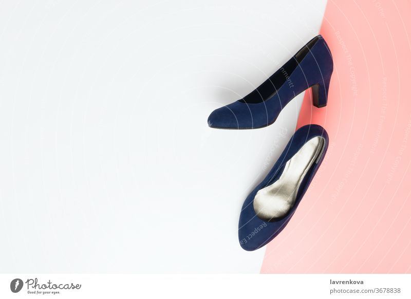 Pastel fashion flatlay arrangement with fashionable blue high heels shoes made of faux leather on pink and white accessories beauty concept feminine flat lay