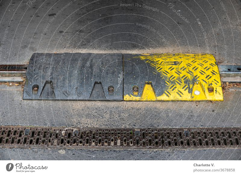 Trip hazard | Metal threshold obstacle Drainage channel gutter Intersection Stumbling block Tar Asphalt Traffic infrastructure Pavement Deserted Colour photo