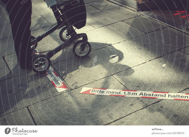 elderly woman with walker maintains distance to protect against corona gap Human being Rollator keep sb./sth. apart mark distance marking
