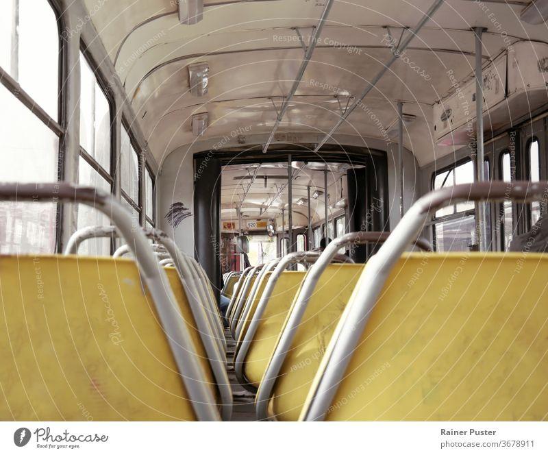 Interior of an old tram in Belgrade, Serbia belgrade inside interior metal public retro train transport transportation vintage weathered seat train seat