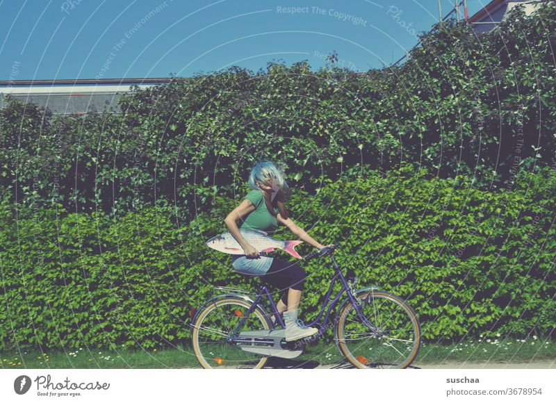 woman on the bike with fish Fish Bicycle ride a bike Crazy Whimsical bollocks wig incognito Strange Hair and hairstyles Wig plem plem off bush green leaves