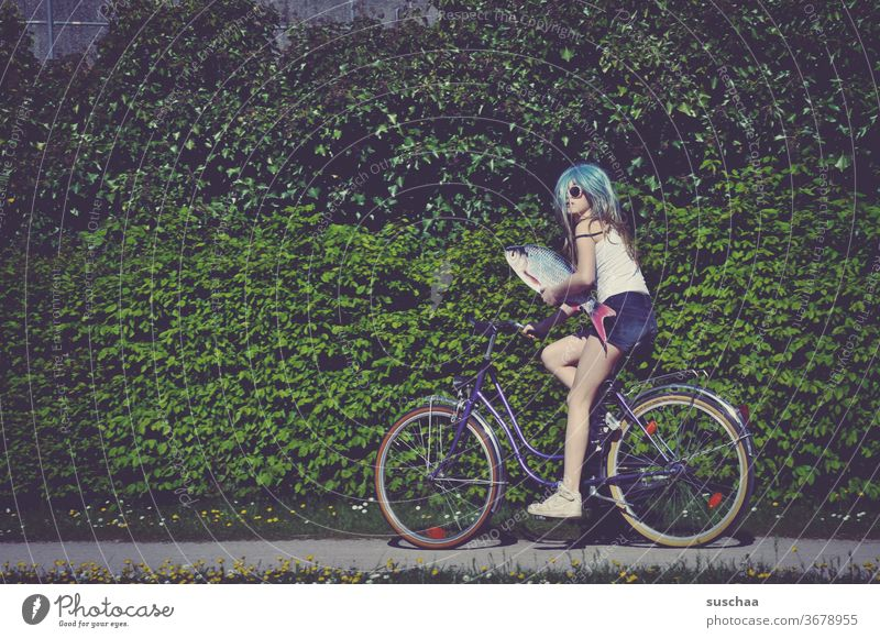 fish, bicycle and a young Fish Bicycle ride a bike Youth (Young adults) teenager Crazy Whimsical bollocks wig incognito Strange girl Puberty Young woman