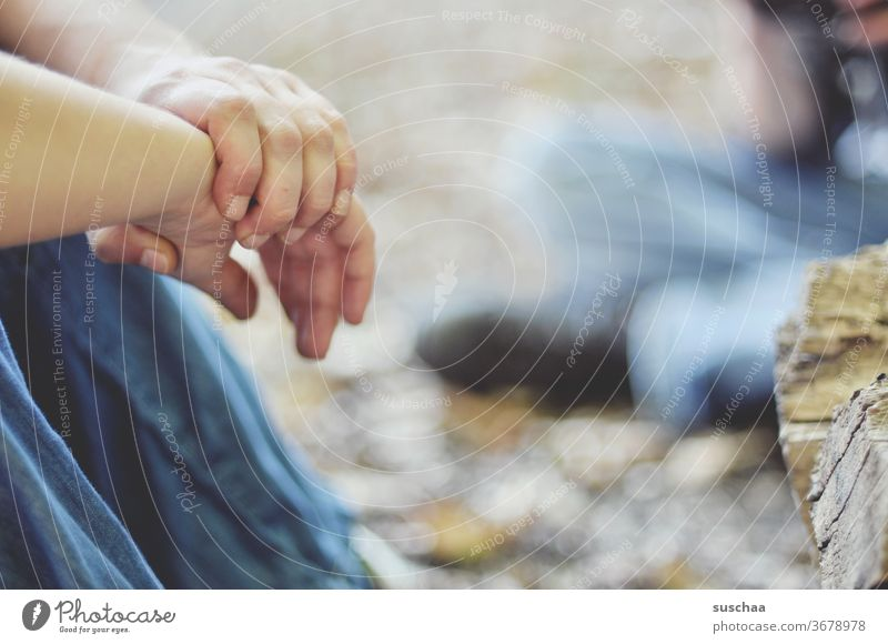 hands of a person sitting on the floor in the open by hand Fingers To hold on Woman Sit sedentary Ground on the ground Outdoors out rest chill