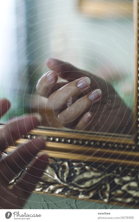 hand in front of a mirror, reflected in it by hand Fingers fingernails Mirror reflection natural Frame Ornate Reflection Mirror image Interior shot