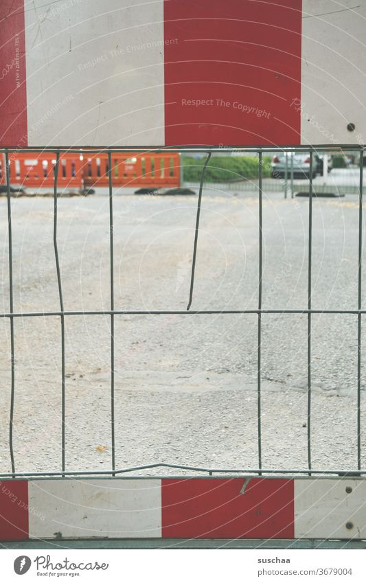 road barrier with hole in fence Street Town Lockdown Roadblock Road Blocking no passage Construction site Fence Hollow aborted iron grid Red White lattice bars