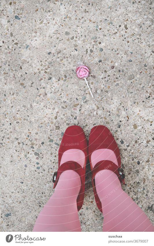 a lollipop on the street with lady's feet Woman Feminine feminine Footwear High heels Ladies' Feet Stockings Street Asphalt Legs Whimsical Pink Red candy Sugar