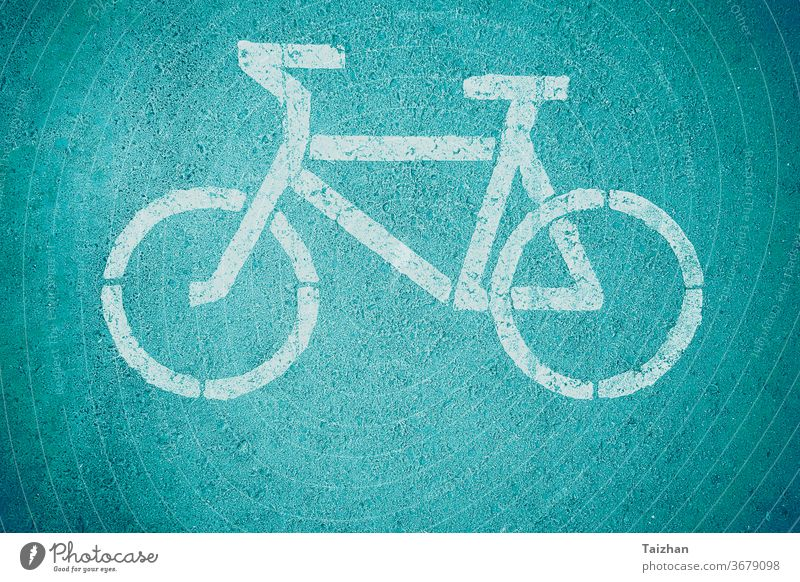 Bicycle road sign , close up . Toned direction path ride safety traffic transport transportation way bicycle bike route wheel cyclist lane white healthy line