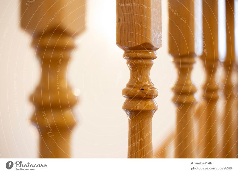 Wooden Railing of an luxury antique staircase, woodwork elements macro photograpy, retro design beautiful interior of a modern house railing home closeup wooden