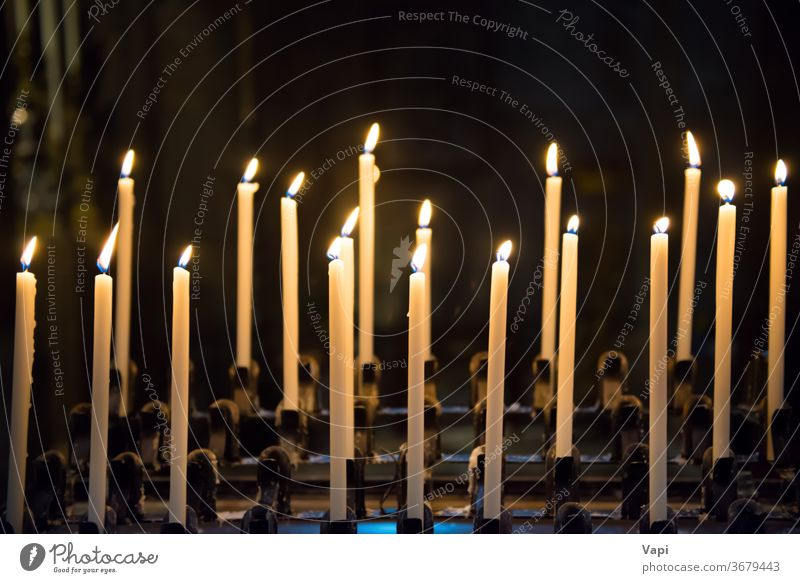 Candles in the church candels candles black blue background light candlelight christmas peace burning yellow flame wax dark religion fire white vintage