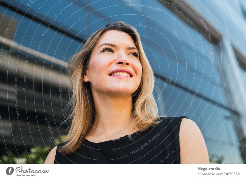 Business woman standing outside office buildings. portrait businesswoman professional young businesspeople corporate manager note career looking attractive hold