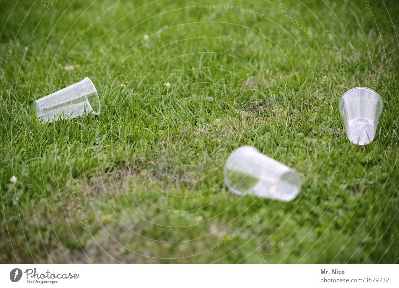 empty plastic cups lie in the grass Mug Trash Environmental pollution Plastic Recycling Packaging waste Meadow Lawn Grass Disposal Plastic cup Throw away Park