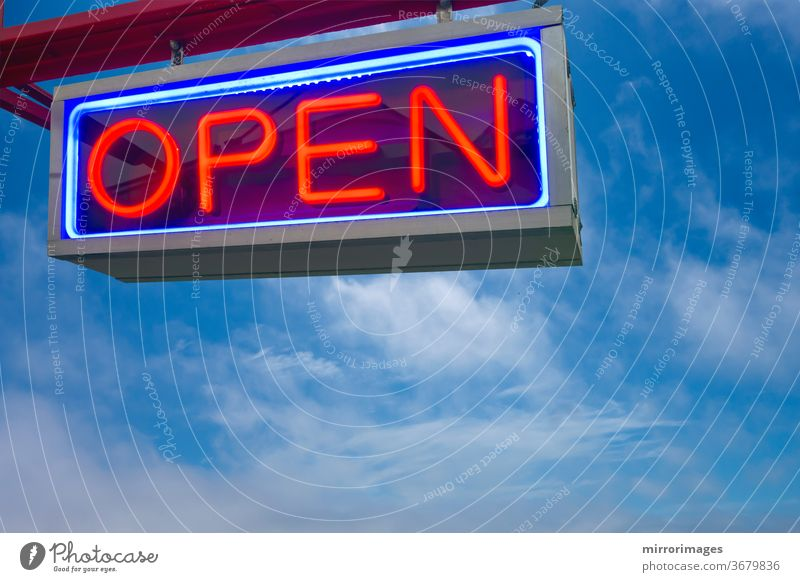 open neon sign red and lue on sky background black blue bright business clouds color commercial concept decoration design electric electricity entrance glow