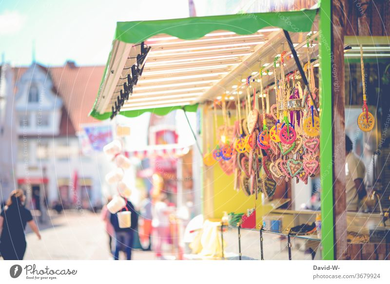 a booth at a carnival funfair Stalls and stands fairground Gingerbread heart sweets Booth owners Stand owner Empty corona void gap Fear forsake sb./sth. broke