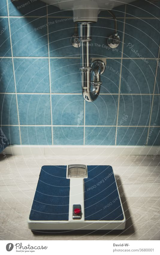 an old scale in a bathroom from a bygone era Scale Old Past Former '60s 1970s Style Weigh Weight Ground Old fashioned Period apartment Blue wall tiles Retro