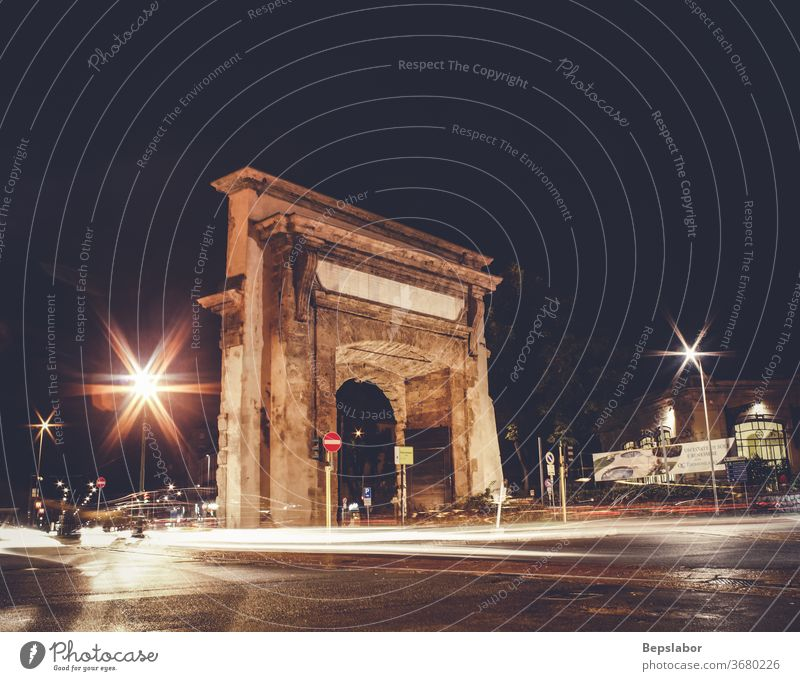 Night view of Porta Romana in Milan, Italy architecture portal sunset light heritage city Italian art arched sculpture tourism travel historic history old