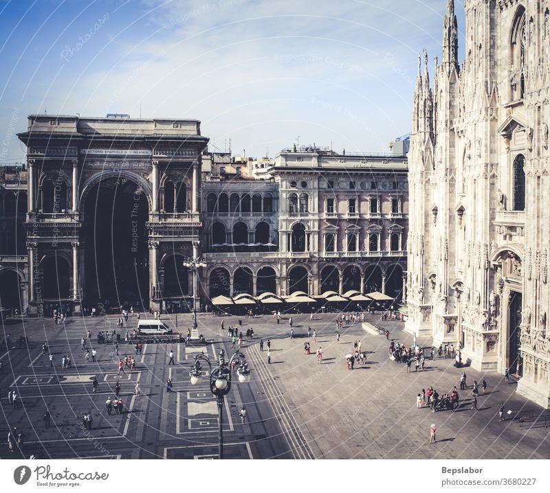 Top view of Duomo square. The duomo and the Vittorio Emanuele II gallery in Milan - Italy architecture art duomo square entrance portal