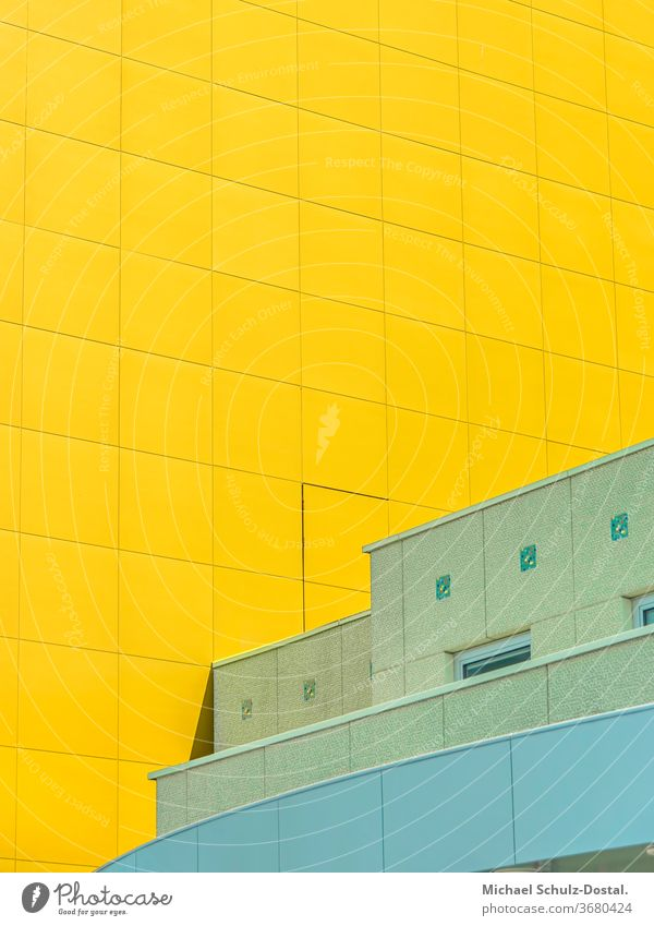 Green house in front of yellow facade minimal graphically colors shape Geometry abstract Abstract Colour Square harmony urban Architecture Line Yellow cyan