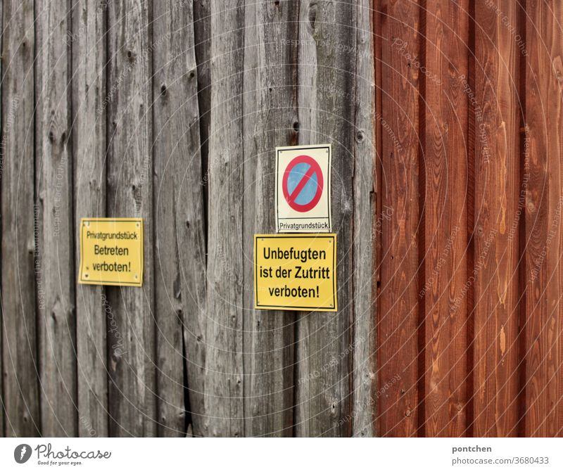 No entry signs on a barn door. Faded wood. Private property Signs Bans No trespassing Private way Barn door Signs and labeling Signage Warning sign Characters