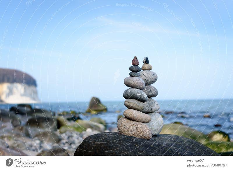 2 cairns are standing on a big boulder on the beach of Rügen's chalk cliffs Limestone rock chalk coast Baltic Sea Baltic coast Beach Cairn Stone Man rock mandl