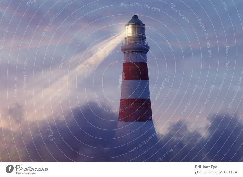 illuminated lighthouse above fluffy clouds Nautical Navigation Vintage colourful Picturesque light tower Construction bank Outdoors Classic coastline Coast