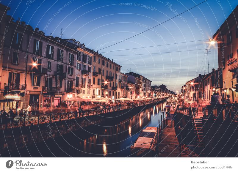 View at sunset of the Naviglio canal in Milan, Italy naviglio milan river italy city street market urban walking water building italian architecture europe