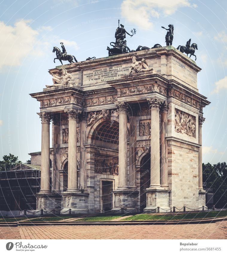 View of the Arco della Pace, triumphal arch in Milan, taly milan architecture gate entrance sempione park bow branches celebration entry heritage lawn italy