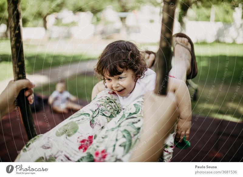 Mother playing with daughter on swing Swing Playground Caucasian Playing Joy Movement To swing Park Child Leisure and hobbies Smiling Human being Happiness