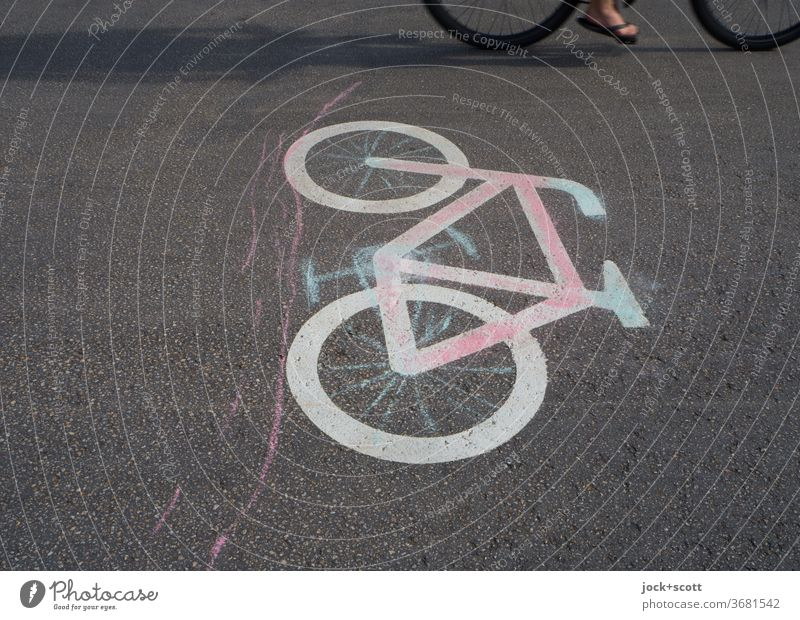 transport by bicycle Pictogram Signs and labeling Sunlight Snapshot Partially visible Street art painted on Traffic infrastructure Symbols and metaphors Wheel