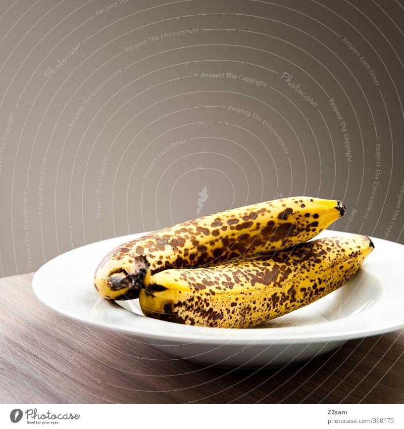 Still Food Fruit Banana Organic produce Vegetarian diet Plate Dark Simple Elegant Healthy Modern Natural Yellow Esthetic Design Sustainability Arrangement Pure