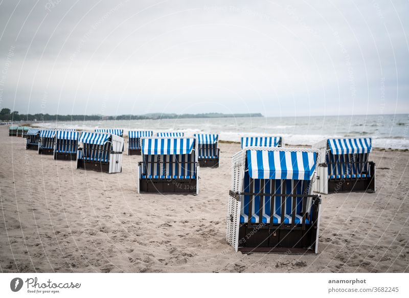 Beach chairs at the Baltic Sea in the early morning in Boltenhagen Ocean beach chair Waves Vacation & Travel Sand Coast Relaxation Summer Sky Water Tourism