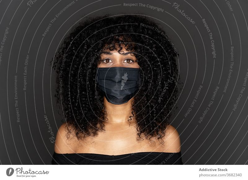 Portrait of african american woman wearing a black mask protection afro breathe breathing calm cannot concern coronavirus covid covid 19 disease diversity