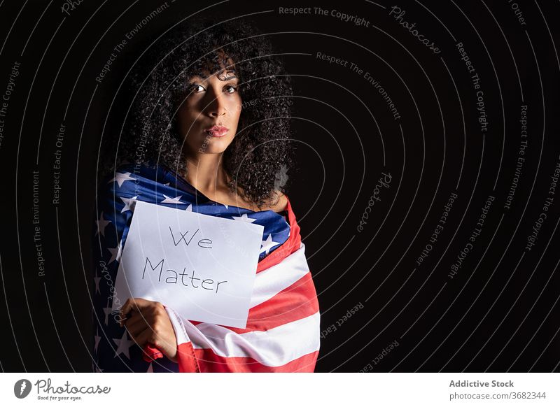 Sad and worried african woman wearing a patriotic american flag activism afro thoughtful usa wrap beautiful black worry community pensive culture diversity