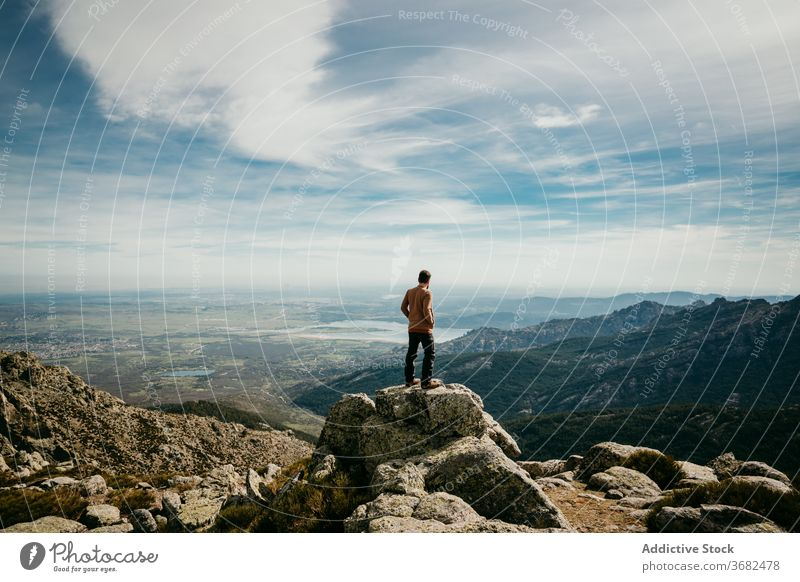 Unrecognizable traveler admiring mountains man ridge admire stone cloudy sky puerto de la morcuera spain male nature trip landscape tourism wanderlust vacation