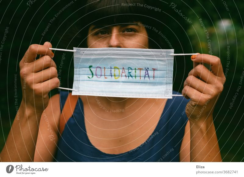 A mouthguard on which the word solidarity is written in colourful letters. Pro Mask duty and masks wear to protect everyone during the Corona pandemic.