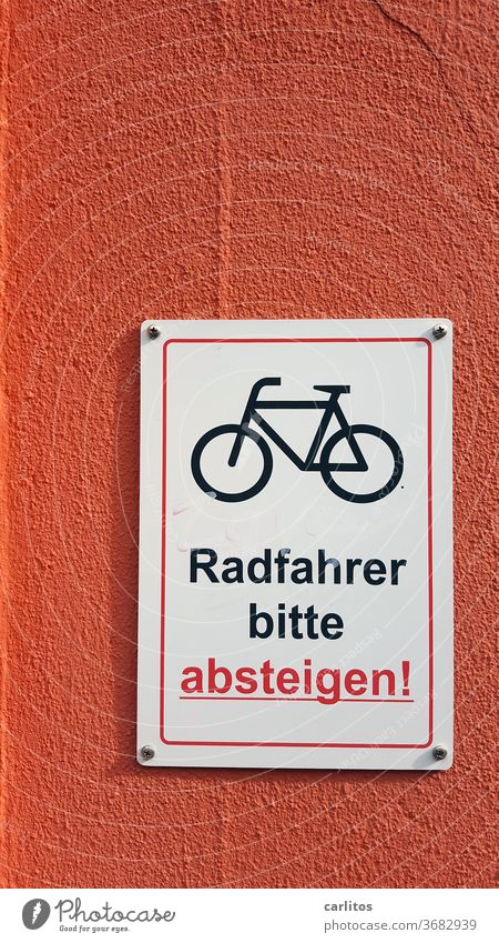 Actually he wanted to cycle to the noble city hotel, but now he was asked to stay in a cheap dosshouse .... Wall (building) sign Bicycle descend Clue Signage